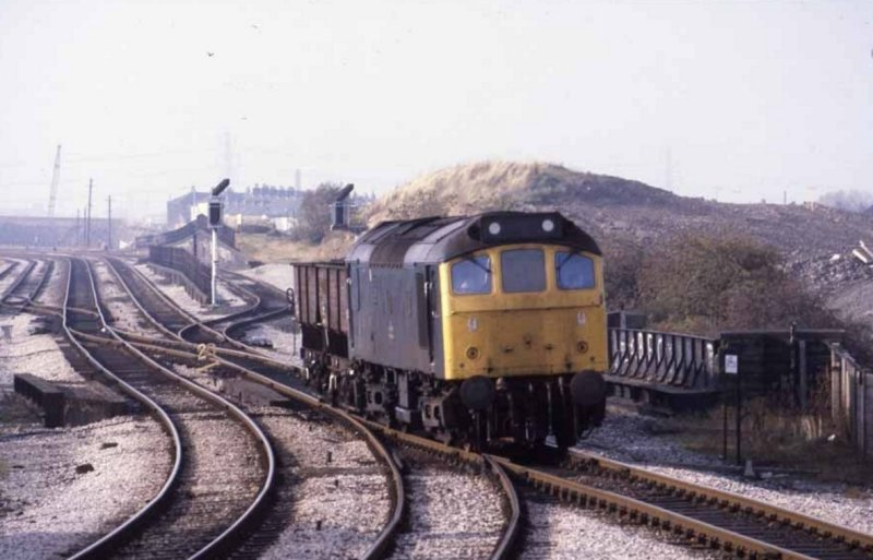 Class 25 25277 heads two loaded coal hoppers at Gannow Junction, taking the line to Colne as it heads for the coal depot at Burnley Central on 29 October 1982.