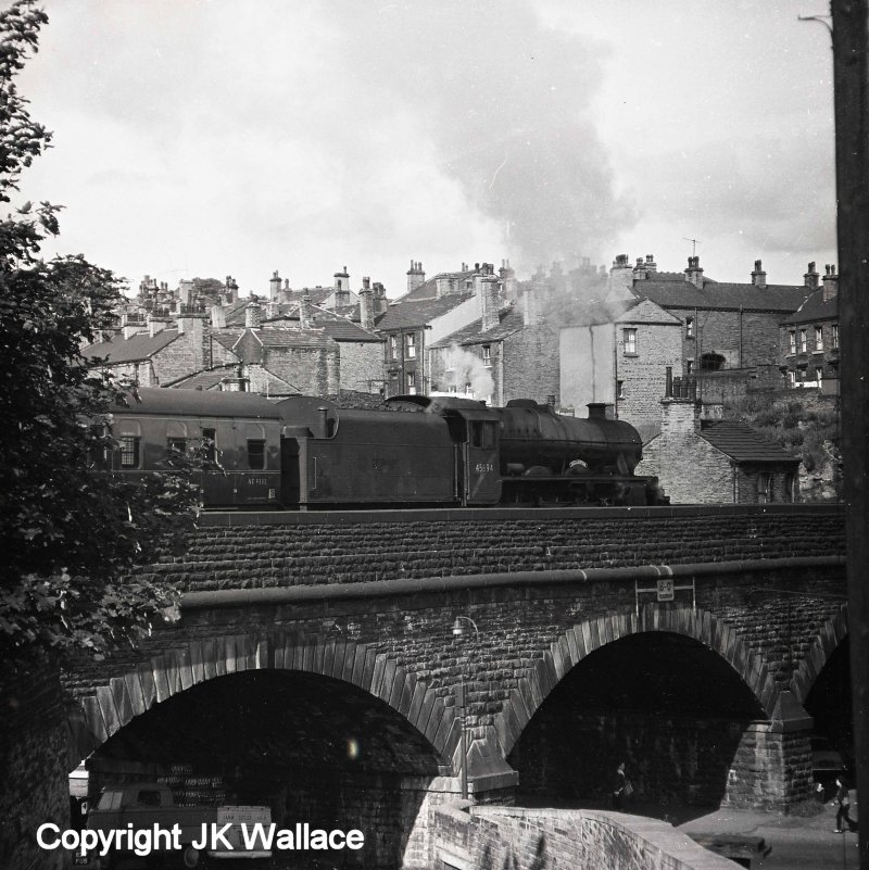 Stanier Jubilee 4-6-0 45694 'Bellerophon' is seen departing from Brighouse with the 08.05 Summer Saturdays only Castleford Central – Blackpool North at around 08.48 on Saturday 9 July 1966