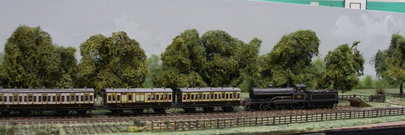 Guy William's Aylesbury (18.2mm gauge) showing the goods yard headshunt as it passes along Stocklake, complete with passenger train and loco 'parked up'.