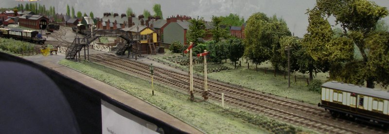 Guy William's Aylesbury (18.2mm gauge) showing the goods yard headshunt as it passes across the Park Street level crossing.