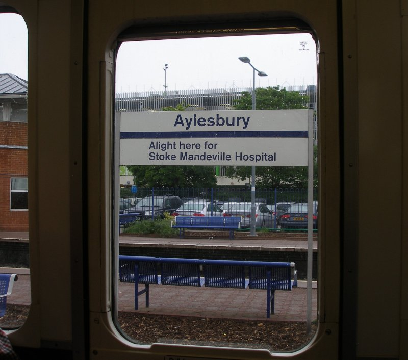 Aylesbury station sign as seen through the window of Class 121 W55034 on 18 May 2017/