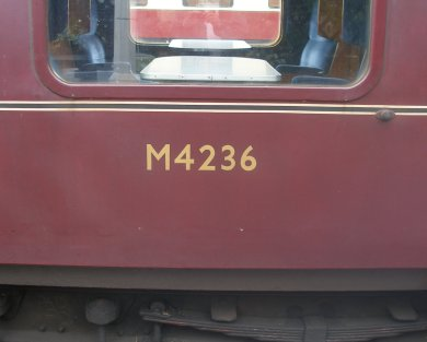 Maroon livery lining and numbering details on a BR Mark 1 carriage at Sheringham 27 August 2016
