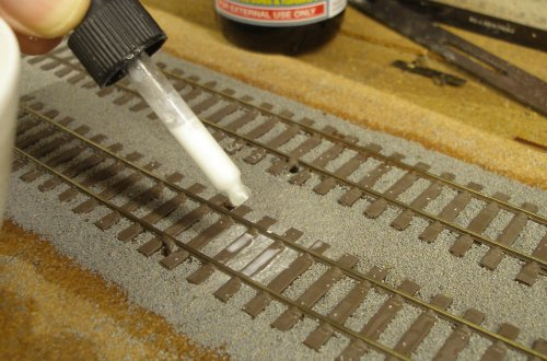 The diluted PVA Wood glue (+dash of washing-up liquid) is applied carefully to the ballast