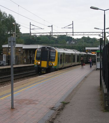 The following 07.42 London Midland service to Birmigham New Street via Northampton draws up at Berkhamsted's Platform 3 formed of 350.247.
