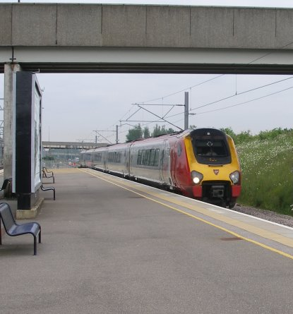 The Virgin Voyager providing the Chester service powers into Milton Keynes at 08.42 on 31 May 2014.