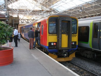 A very full Class 153 at Crewe on 31 May 2014