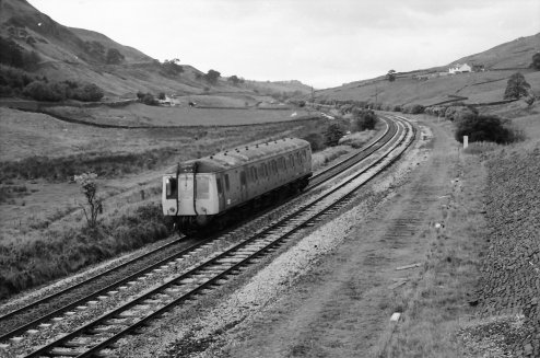 Class 121 or 122 heads away from Todmorden at Copy Pit, passing the site of the old loop, on a route learning trip on 24/9/1984