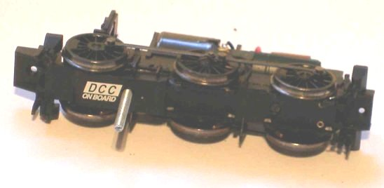 Chassis with bolt inserted through Bachmann Pannier tank keeper plate