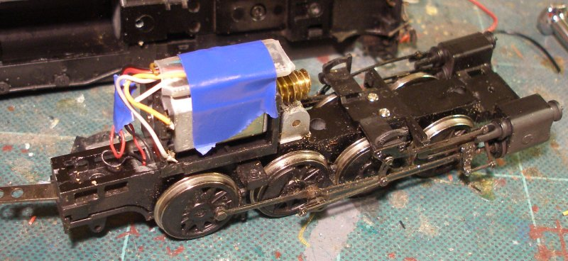 A Zimo MX600R hard wired into a Bachmann WD Austerity 2-8-0 showing it fitted above the motor.