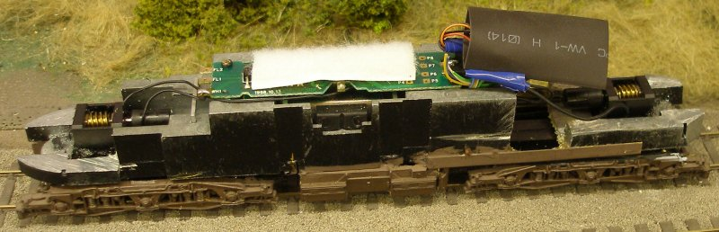Class 47 showing the revived Lenz 1025 plugged into the 8-pin socket and the Hornby insulating sleeve slipped over the decoder.