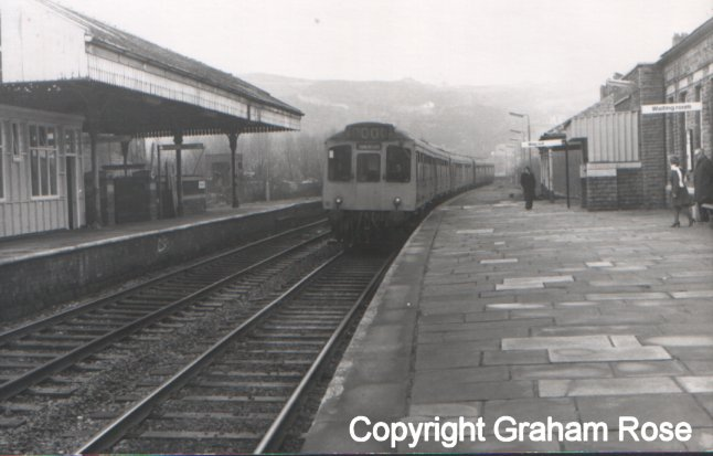 A 2 x 3-car Class 110 sets arrive at Todmorden, heading for Manchester Victoria on a wet day in the 1980s.