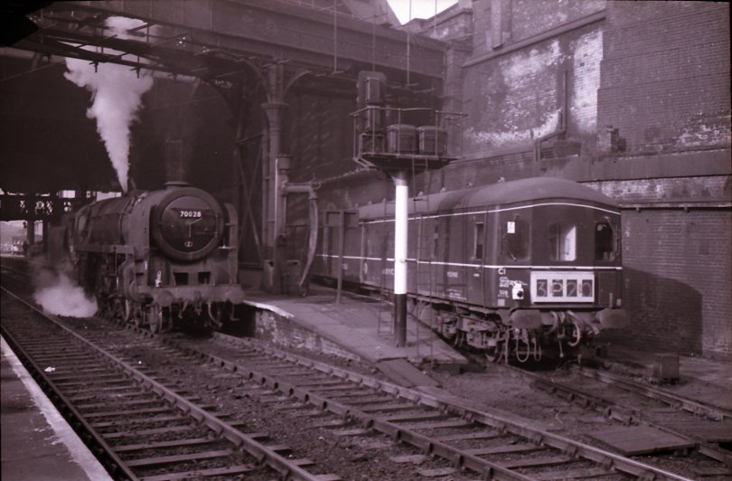 Manchester Victoria East End with Britannia Pacific 70028 and Class 128 Parcels DMU M55983 in the Parcels Bay sometime in the mid-1960s