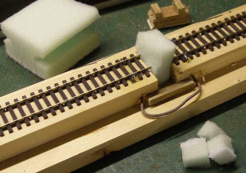 Construction of an OO gauge locomotive wheel cleaning track: kitchen cleaning pad