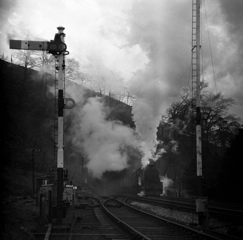 Stanier 8F 48466 bursts out of Holme Tunnel and arrives at Copy Pit with a Yorkshire bound haul of empty coal wagons.