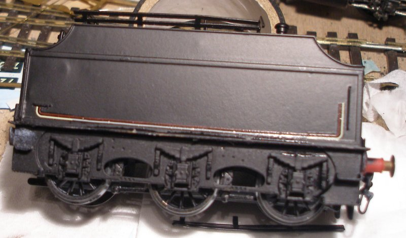 Model railway varnishes failed completely and the tender of the DJH Crab has been stripped back to bare metal, and the body resprayed using Halford's matt black car spray. The second set of lining transfers are being applied.