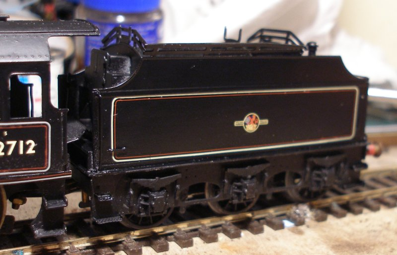 Three quarters front view of a 4mm (OO) DJH Fowler tender as attached to a Crab 2-6-0 in late BR mixed traffic livery with Fox Transfers and varnished with Ronseal Satin varnish.