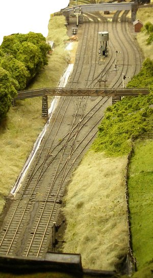 The 4mm scale (1:76) model railway layout of Hall Royd Junction on 20 September 2015, showing bridge 109 in place and trees slowing populating the embankments.