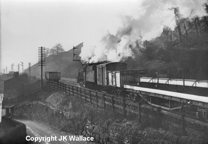 LMS Stanier 8F 48319 passg Eastwood with a westbound pick-up freight at 10.50 a.m. on Saturday 28 December 1963.