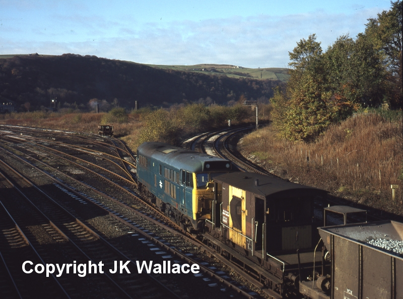 Brush Type 2 31290 enters the engineering sidings at Hall Royd Junction with a Permanent Way train on 12 November 1980