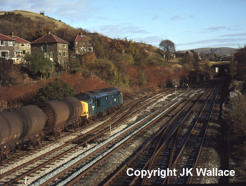 English Electric Class 37 37252 passes Hall Royd Junction with empty oil tanks on 12 November 1980.