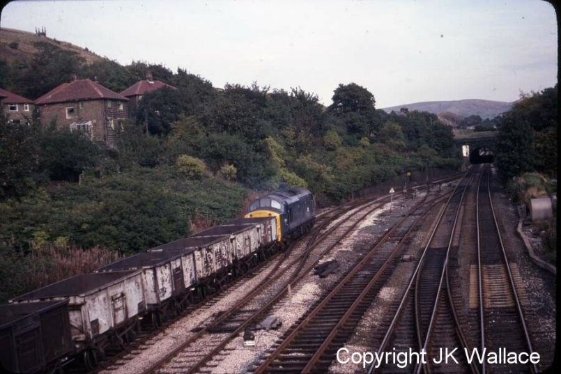 BR Class 37 37103 passes Hall Royd Junction heading eastwards with an enmpty mineral train from Rose Grove on 8 October 1979