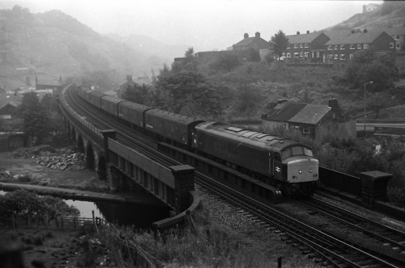 Peak Class 45 45130 crosses Gauxholme Viaduct with the empty Red Bank parcels train returning to Manchester on 28 September 1983