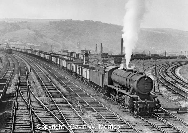 Gavin Morrison has kindly allowed reproduction of his photo showing Riddles 'WD' class 2-8-0 No. 90523 with a eastbound coal freight heading for Healey Mills on the Lancashire & Yorkshire down loop on 14 June 1961.