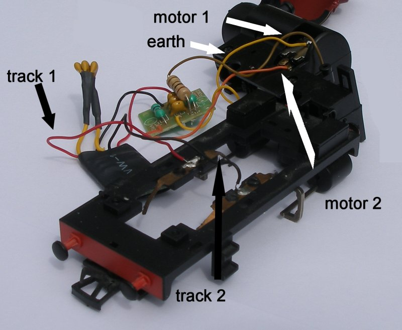 Bachmann 'Greg' DCC starter set 0-4-0 OO gauge loco showing internal wiring and decoder as fitted, and with the fifth yellow wire connecting the circuit board to the motor casing, with wires marked up.