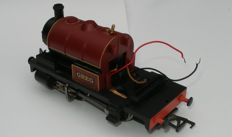 Bachmann starter-set loco 'Greg' re-assembled showing red and black, and orange and grey wires waiting for the addition of a conventional DCC socket.