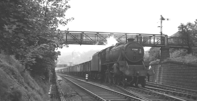 Black 5 45260 passes under Lower Laithe House footbridge on 23 July 1966 with a Yorkshire-bound train of empty coal wagons