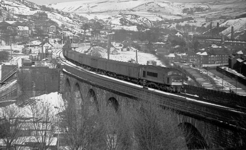 Empty newspaper vans from Newcastle for Manchester Red Bank heads through Todmorden on Sunday 3 April 1966 at 17:30 hauled by Class 45 Peak D81.