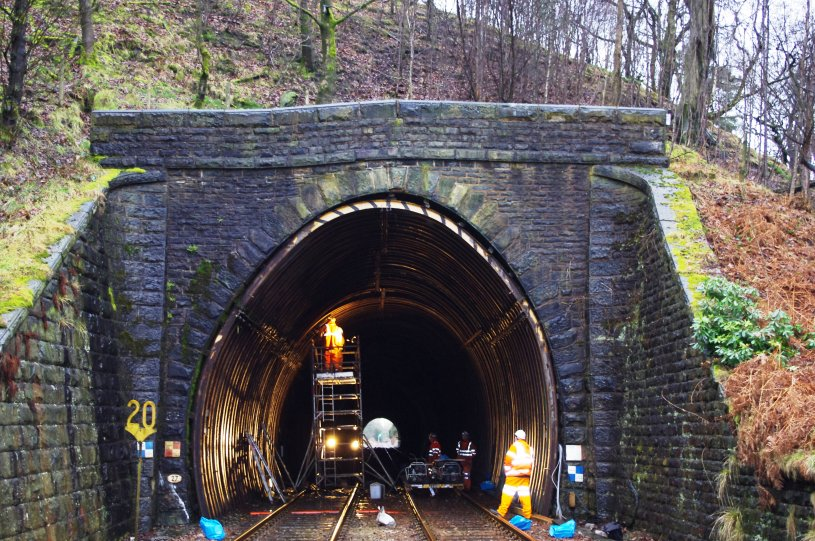 Holme Tunnel southern portal prior to work starting with 20 mph speed restriction sign still in place.