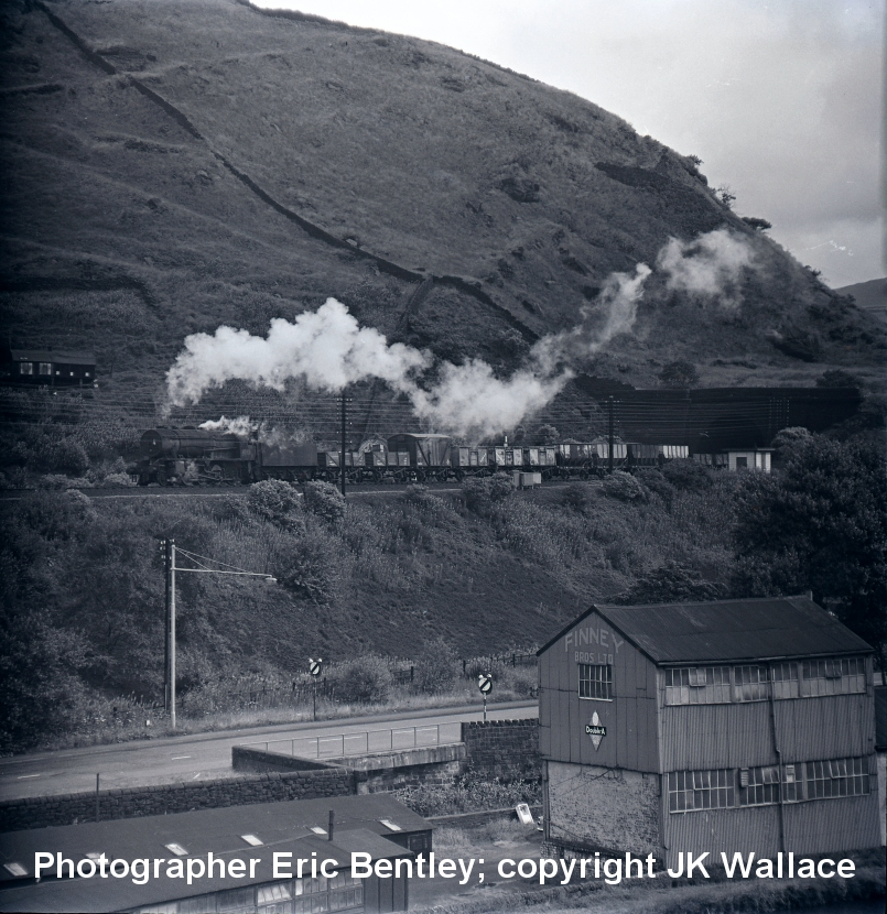 WD 2-8-0 90481 between Hebden Bridge & Todmorden exiting Horsefield Tunnel with a westbound mixed freight 30 July 1966. Photograher Eric Bentley, copyright JK Wallace