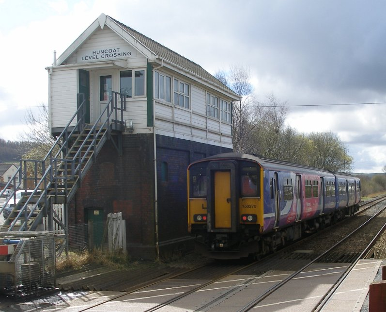 Huncoat Crossing Box on 23 March 2014, with Sprinter 150.270 working a Colne - Blackpool South service.