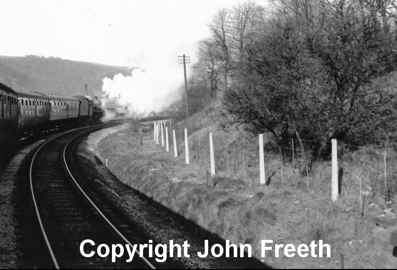 Jubilee 45593 Kolhapur (now preserved) takes the curve between Hall Royd Junction and Stansfield Hall Junction on the climb to Copy Pit with 1X10 a Bradford to Blackpool excursion train on Easter Monday 27 March 1967. Copyright John Freeth