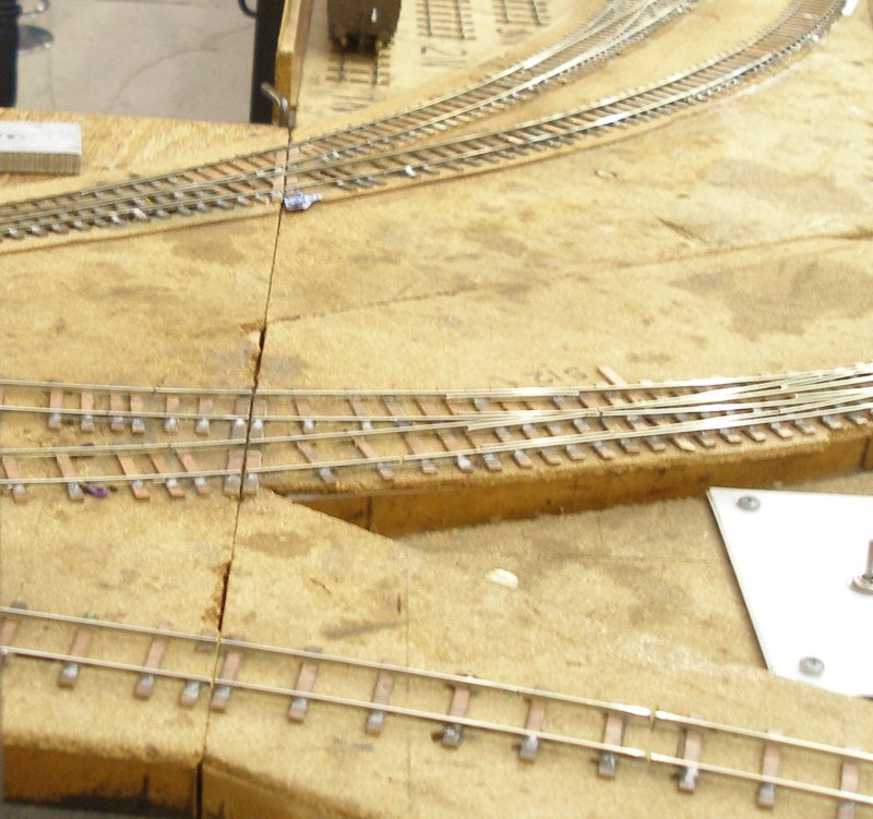 Shipley Model Railway Society's Leicester South layout baseboad joint showing use of PCB to secure the rails at the joint.