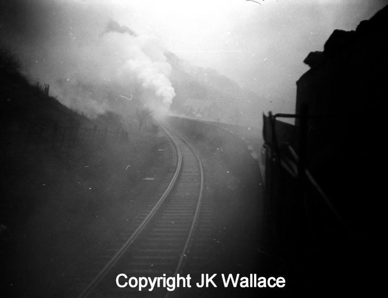 An up mineral bound seen from the footplate of the lead WD Austerity 2-8-0 bound for Copy Pit erupts from Kitson Tunnel with the banker fully engaged.