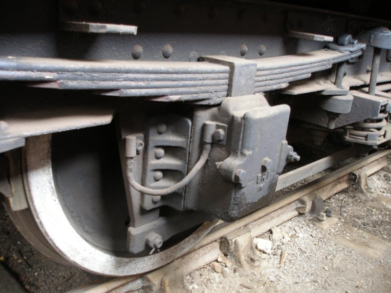 BR Mark 1 coach underframe detail: axle box showing spring stops and earthing cable