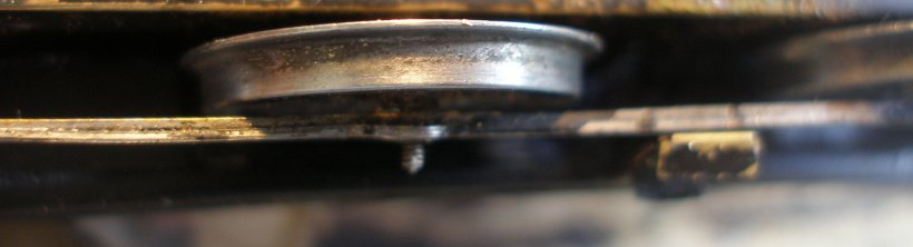 Uninsulated alloy (unplated) Romford driving wheel showing the dirt picked up