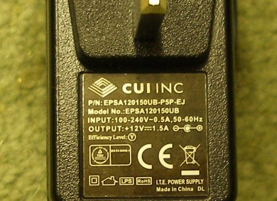 NCE Powercab UK 13-amp power adaptor with 230 volt input and 12 volt output showing label