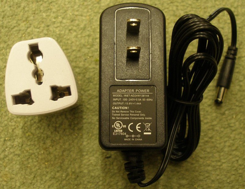 NCE Powercab USA-style power adapter and converter plug for the UK.