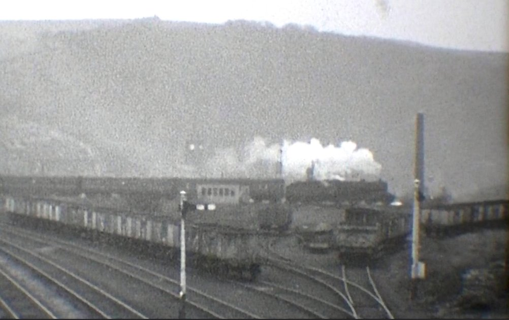 Crab with empty excursion stock heads 'right line' from Todmorden West to Stansfield Hall Junction courtesy 'Steam World' TeleRail video  and Richard Greenwood.