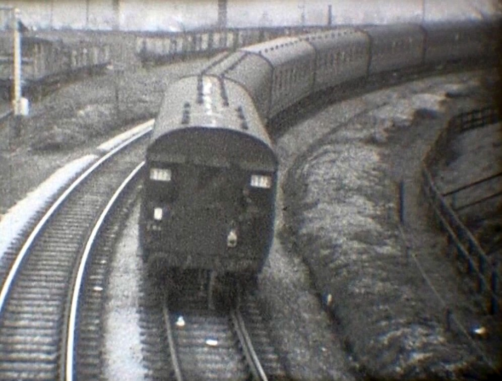 Crab propels the empty excursion stock towards Hall Royd Road birdge on the second side of the triangle, having reversed over the trailing cross-over at Stansfield Hall Junction courtesy 'Steam World' TeleRail video and Richard Greenwood.