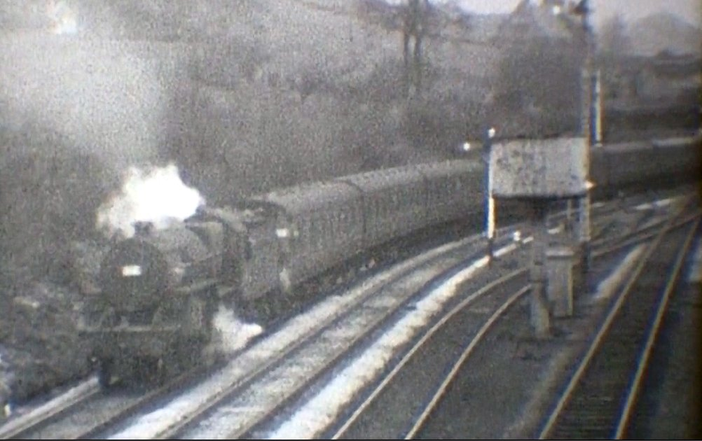 The Crab continues to propel the empty excursion stock towards Hall Royd Junction, courtesy 'Steam World' TeleRail video  and Richard Greenwood.
