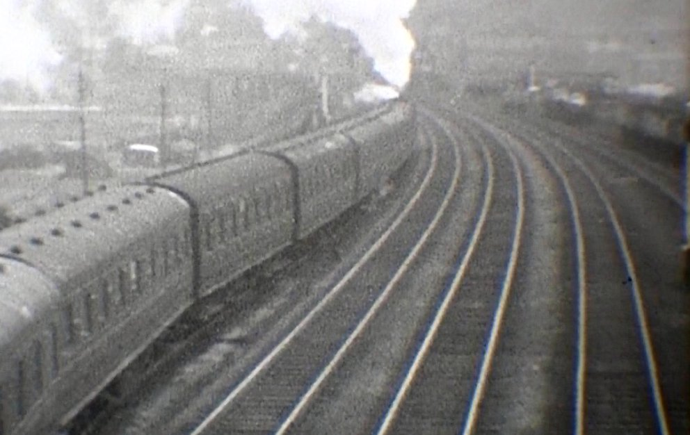 The train now passes back under Hall Royd Road bridge and then enters the Up passenger loop. Presumably it would then be held in this loop waiting time, and allowing booked services to pass, before moving down to Todmorden station. Courtesy 'Steam World' TeleRail video and Richard Greenwood.