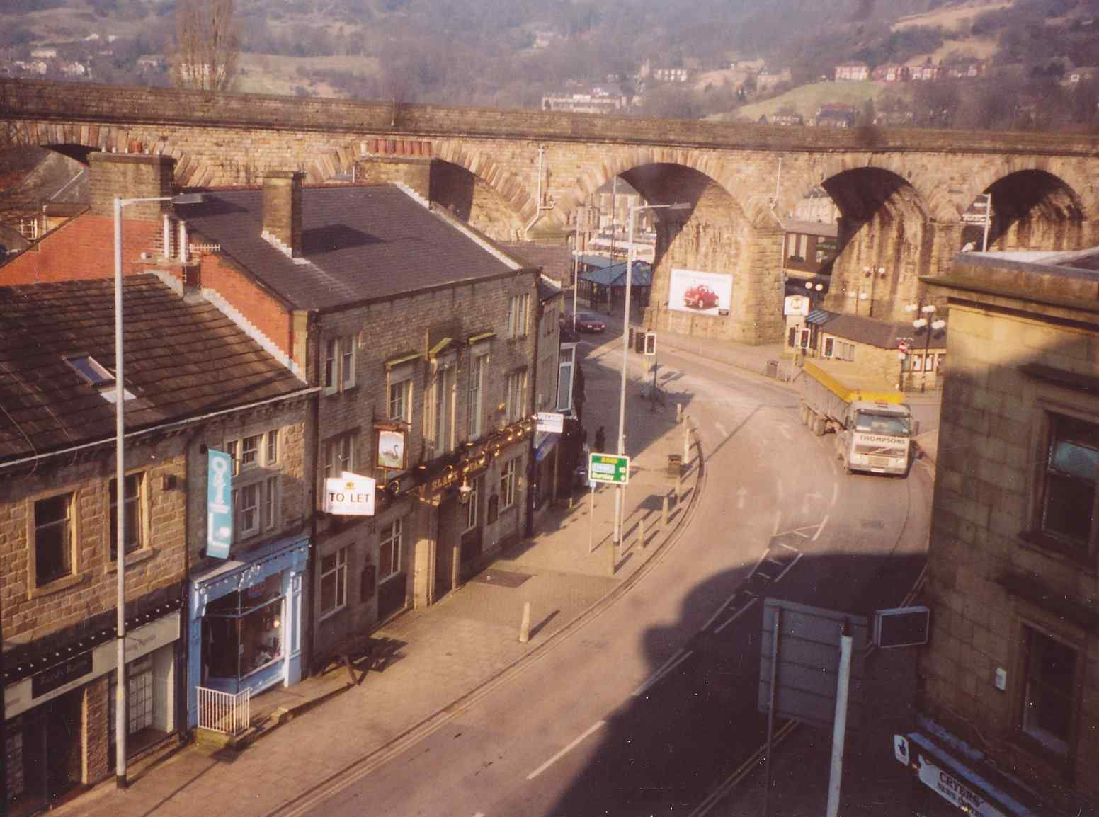 Photo of Burnley Road shops and the 'Black Swan' pub taken from the attic of the Town Hall c. 2008 showing railway viaduct.