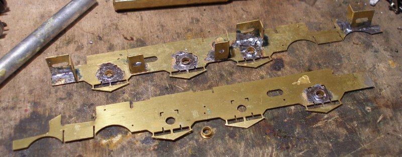 The top hat bearings are soldered into the frames.