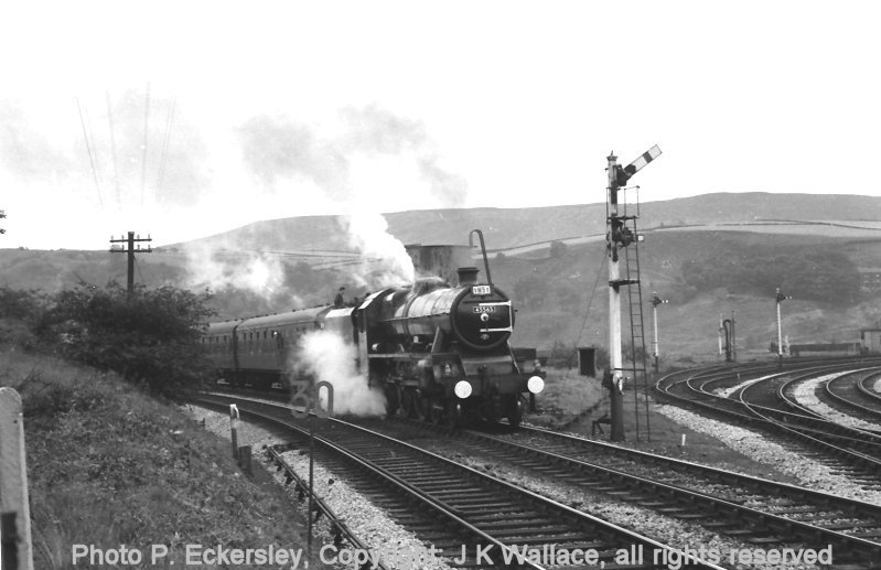 Jubilee 45565 stands at Stansfield Hall Junction taking water whilst heading special 1M91 on 23 July 1966