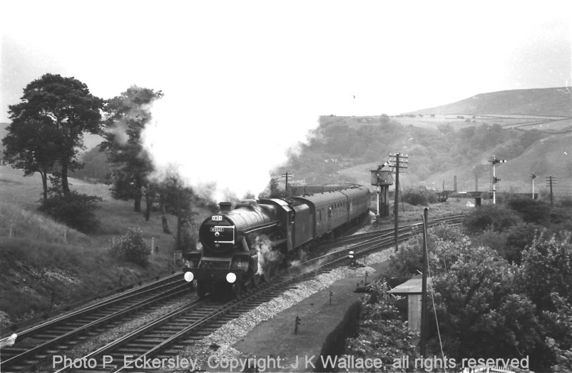 Stanier ex-LMS Jubilee 45565 'Victoria' gets away from Stansfield Hall Junction, Todmorden, having taking water there whilst heading special 1M91, assumed to be Blackpool bound, on 23 July 1966
