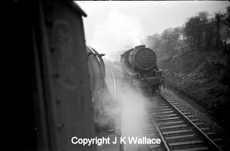 Two WD Austerity 2-8-0s pass at Stansfield Hall on the Copy Pit line. 90364 is approaching with a brake van.